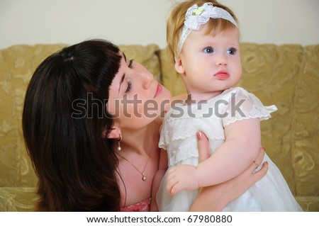 Mother and daughter having fun together. symbol of family