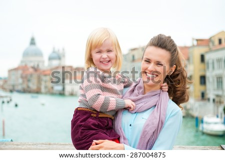 Mother and daughter having fun together while sight-seeing... That's the way to do it! - stock photo