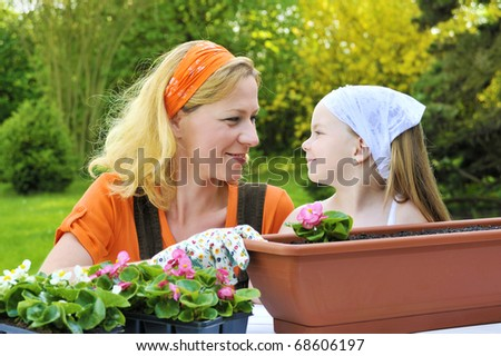 Mother and daughter having gardening time - stock photo