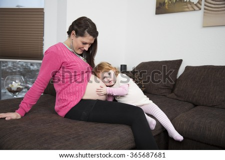 Mother and daughter, hearing, pregnant belly