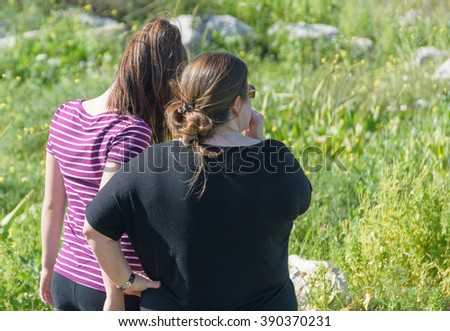 Mother and daughter hiking in a middle -eastern pine forest in Israel  in the Sharon area near Tel Aviv - stock photo
