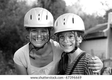 mother and daughter horseback riding - stock photo