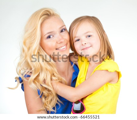 Mother and daughter hug - stock photo