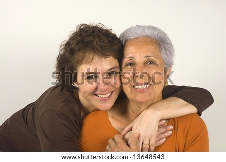 Mother and daughter hugging each other - stock photo