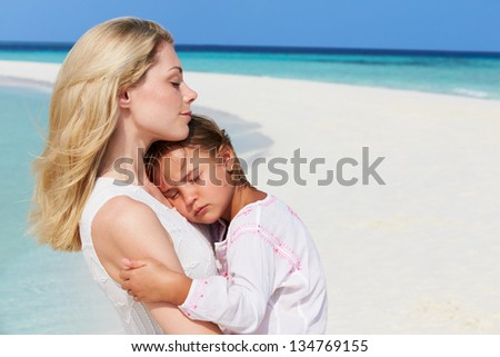 Mother And Daughter Hugging On Beautiful Beach - stock photo