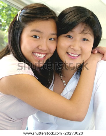 Mother and daughter hugging on Mother's Day - stock photo