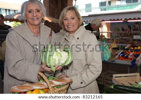 mother and daughter in a market - stock photo