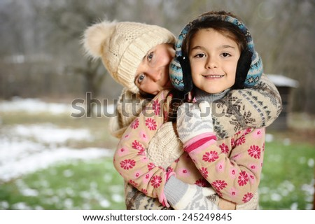 Mother and daughter in a wonderful warm sweater. Christmas time - stock photo