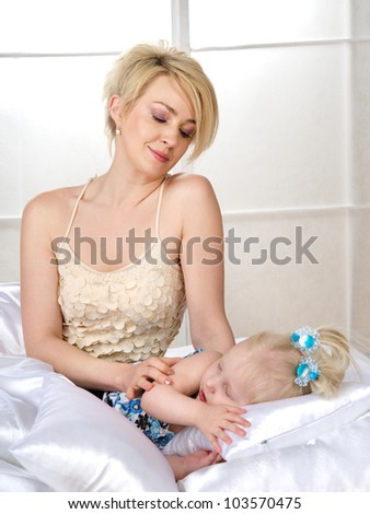 Mother and daughter in bed - stock photo