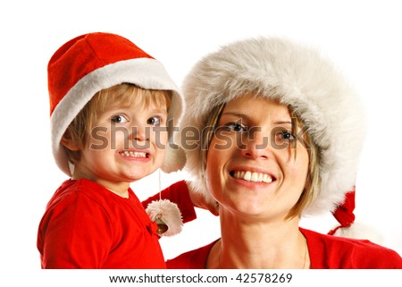 mother and daughter in Christmas hut - stock photo
