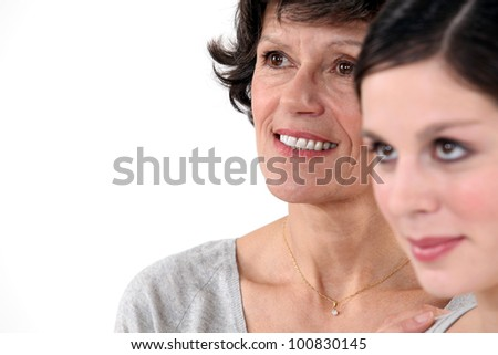 Mother and daughter in studio - stock photo