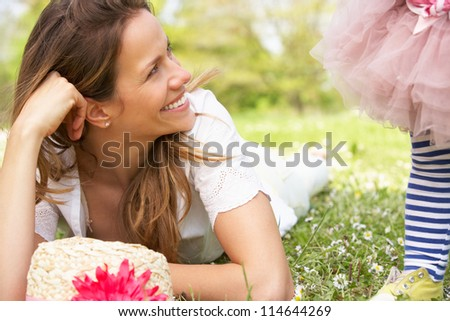 Mother And Daughter In Summer Field Together - stock photo