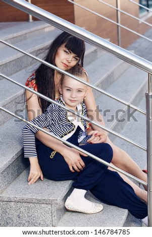 Mother and daughter in the city - stock photo