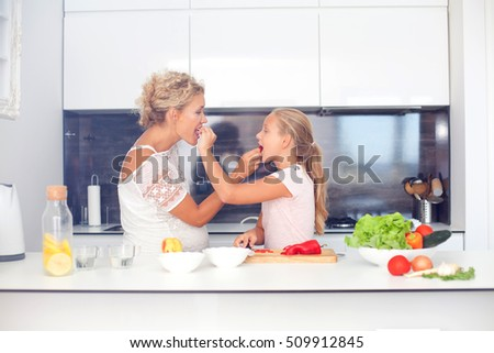 Mother and daughter in the kitchen preparing food