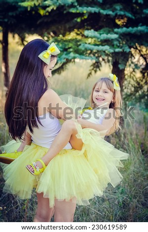 Mother and daughter in the park - stock photo