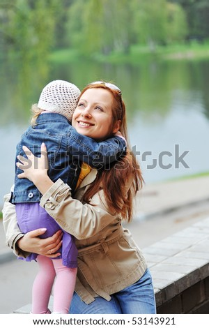 Mother and daughter in the spring  park