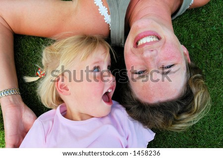 Mother and daughter laying in the park