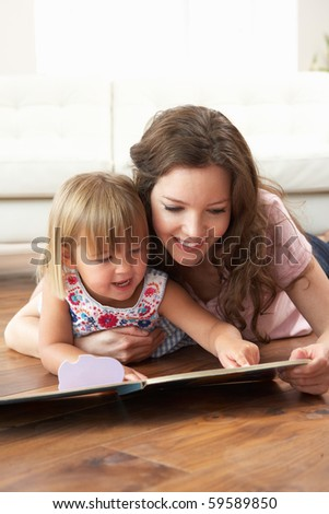 Mother And Daughter Learning To Read At Home - stock photo