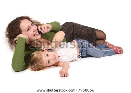 mother and daughter lie they talk on the cell phones on the the white - stock photo