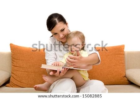 mother and daughter on sofa - stock photo