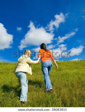Mother and daughter on the field - stock photo