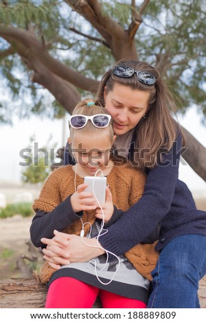 mother and daughter on the walk family a summer day - stock photo