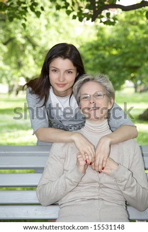 Mother and daughter on the walk in park - stock photo