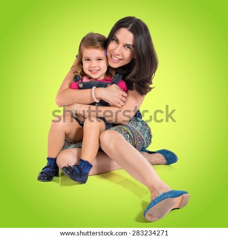 Mother and daughter over colorful background - stock photo