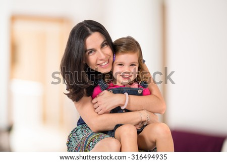 Mother and daughter over textured background - stock photo