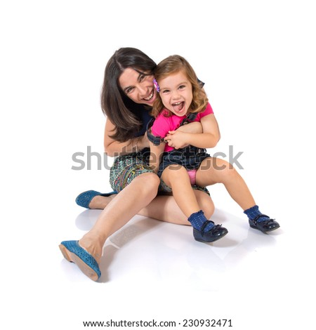 Mother and daughter over white background - stock photo