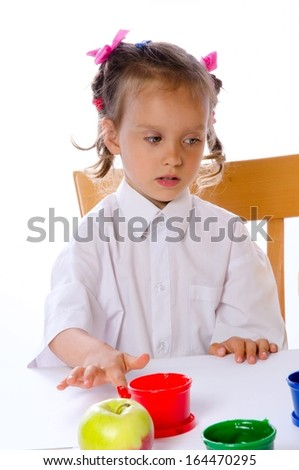 mother and daughter paint with finger - stock photo