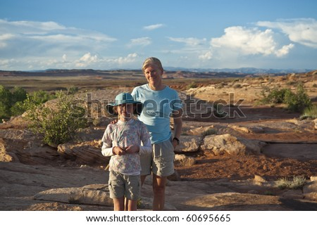 Mother and daughter pausing on a hike in the desert