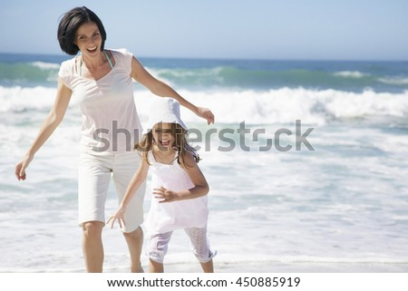 Mother and Daughter Playing Together at the Beach in summer vacation day