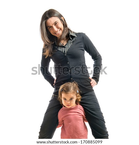 mother and daughter playing together over white background