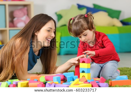 High Quality Mother And Daughter Playing Together With Colorful Construction Toys On A  Carpet On The Floor Af