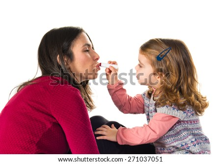 Mother and daughter playing with makeup