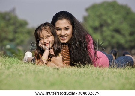 Mother and daughter posing - stock photo