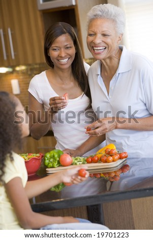 Mother And Daughter Preparing meal,mealtime Together