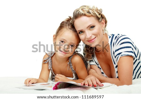 Mother and daughter reading journal on white background.