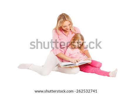 Mother and daughter reading on white background. - stock photo