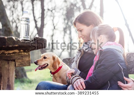Mother and daughter relaxing in the park - stock photo