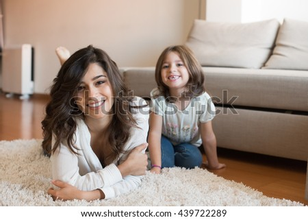 Mother and daughter relaxing together at home