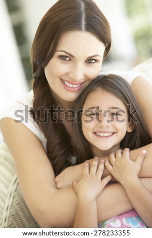 Mother And Daughter Relaxing Together In Chair - stock photo