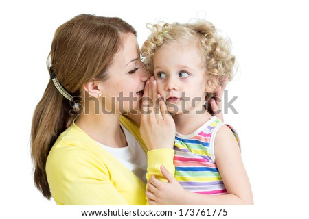 mother and daughter sharing a secret whispering - stock photo
