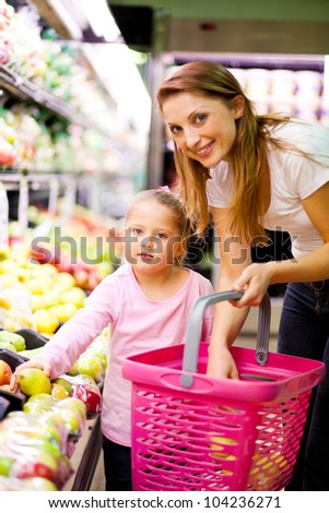 mother and daughter shopping in market