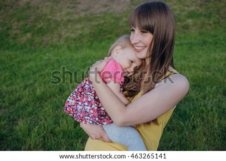 mother and daughter sitting in a cafe, walking in the park and play