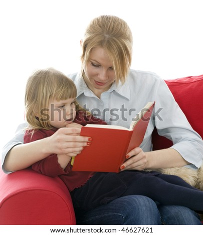 mother and daughter sitting on red sofa and reading book