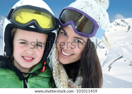 Mother and daughter skiing in the mountain