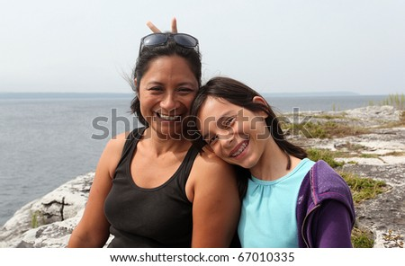mother and daughter smiling - stock photo