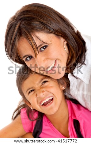 Mother and daughter smiling isolated over a white background